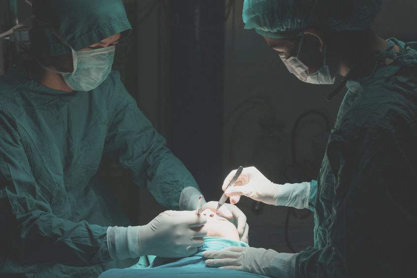 Plastic surgery wrinkle reduction , asian man during surgery usi